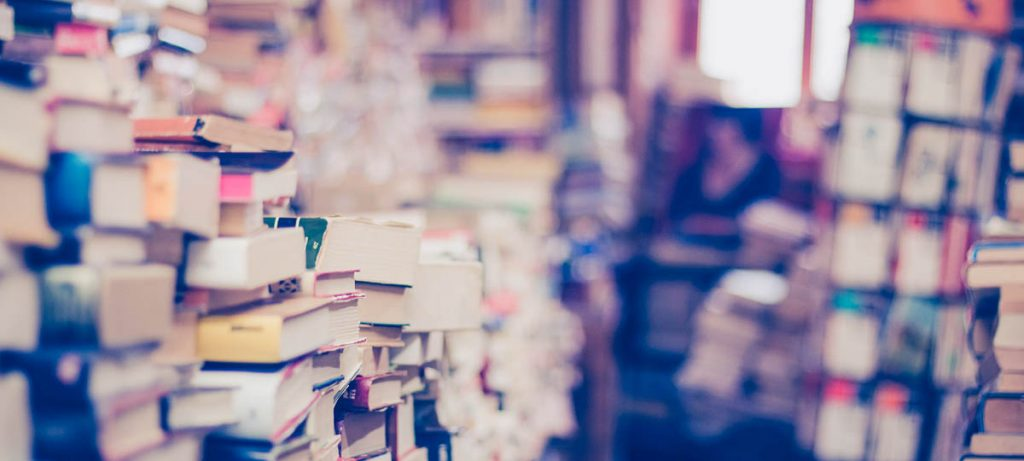Lots of stacks of books, rental guarantee from A to Z.