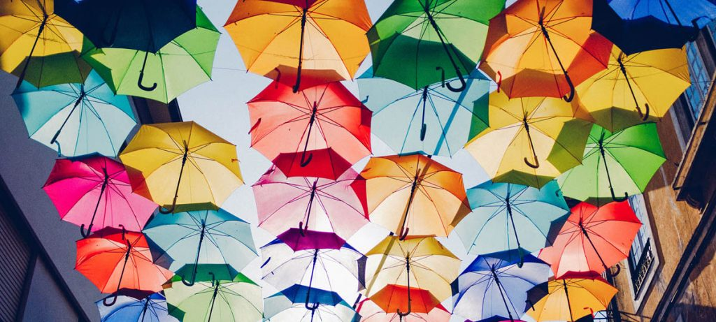 A colourful array of different open umbrellas from below, the importance and benefits of home credit insurance.