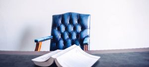 Chair in a legal office setting, what information is necessary by law in your listing.