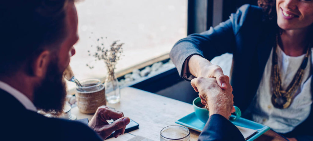 2 people shaking hands over coffee, how to solve conflicts with your tenets.