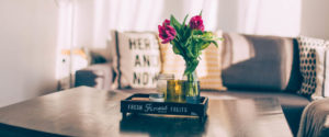 cosy appartment with flowers on wooden table, buying your home in 7 essential steps.