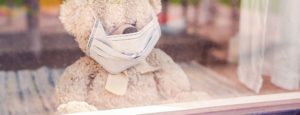 Teddy bear wearing medical mask, coronavirus and real estate sector