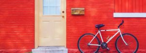 porte d'entrée avec mur rouge, combien emprunter pour acheter