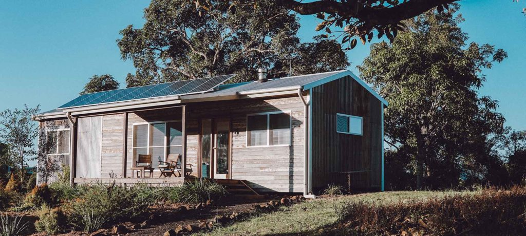 modern tiny house with solar panels on the roof